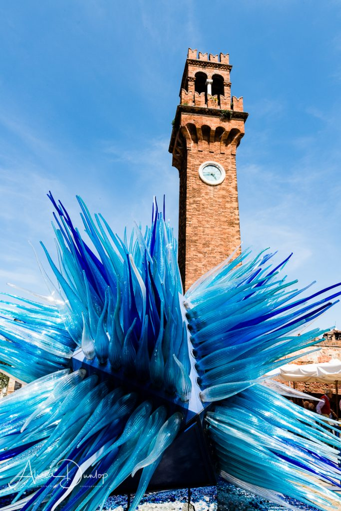 Glass sculpture in front of Murano's bell tower - Venice in Spring series things to do in Venice